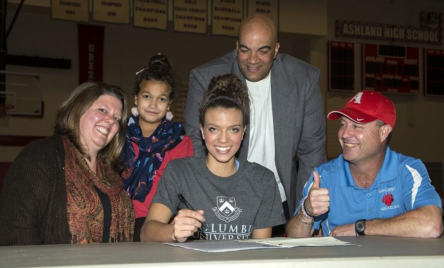 Georgia Williams signs her National Letter of Intent to play at Columbia University as Athletic Director Karl Kemper and her family look on