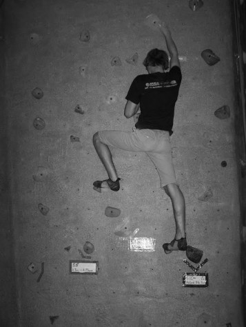 Nidalmia ascends the wall at The Rogue Rock Gym.