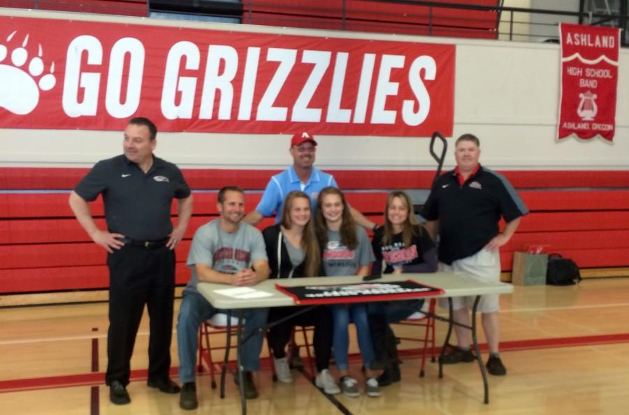 Sydney+Norvell+and+family+celebrate+after+she+signs+her+letter.