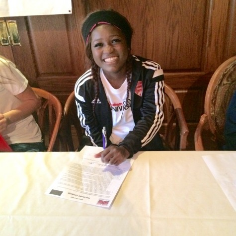Facie Graham signing her letter of intent.