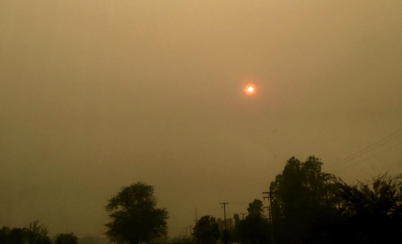 Dark smoky side with bright orange moon